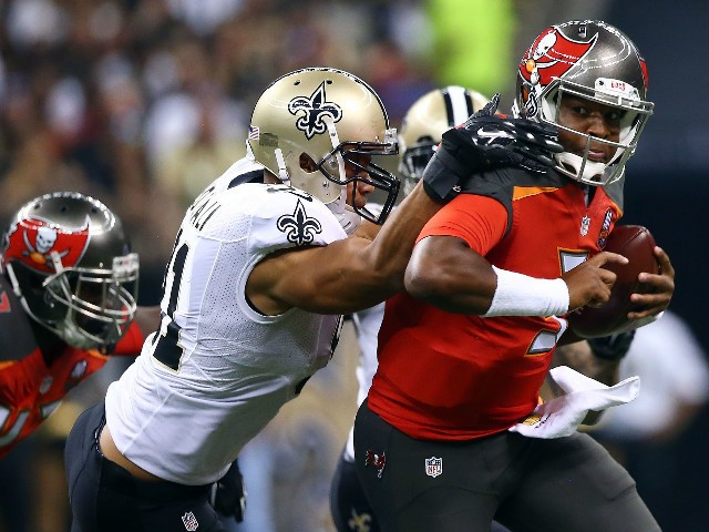 Jameis Winston #3 of the Tampa Bay Buccaneers is pursued by Kasim Edebali #91 of the New Orleans Saints during the first quarter of a game at the Mercedes-Benz Superdome on September 20, 2015 in New Orleans, Louisiana.
