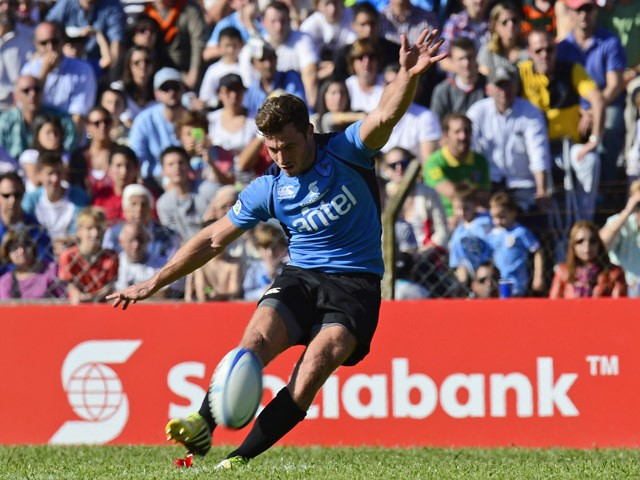 Uruguay's outside half Felipe Berchesi kicks the ball to score against Russia during the run-off qualifier match for Rugby World Cup 2015, at Charrua stadium in Montevideo on October 11, 2014