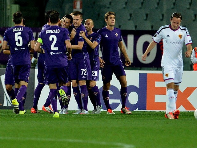 Fiorentina's players celebrate during the UEFA Europa League football match Fiorentina vs Basel on September 17, 2015