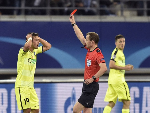 Gent's midfielder Brecht Dejaegere receives a red card by referee William Collum during the UEFA Champions League football match between Kaa Gent and Olympique Lyonnais (OL) at Ghelamco stadium in Ghent, on September 16, 2015