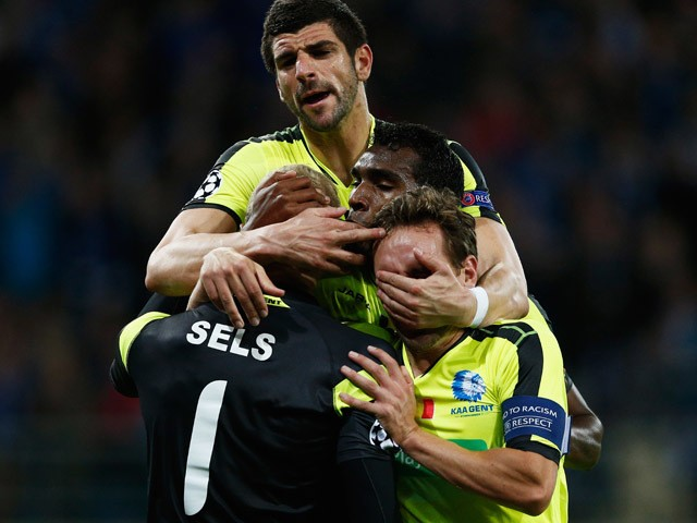 Goalkeeper, Matz Sels of Gent is congratulated by team mates Sven Kums, Renato Cardoso Neto and Stefan Mitrovic after he saves a penalty in the final minutes during the UEFA Champions League Group H match between KAA Gent and Olympique Lyonnais held at Gh