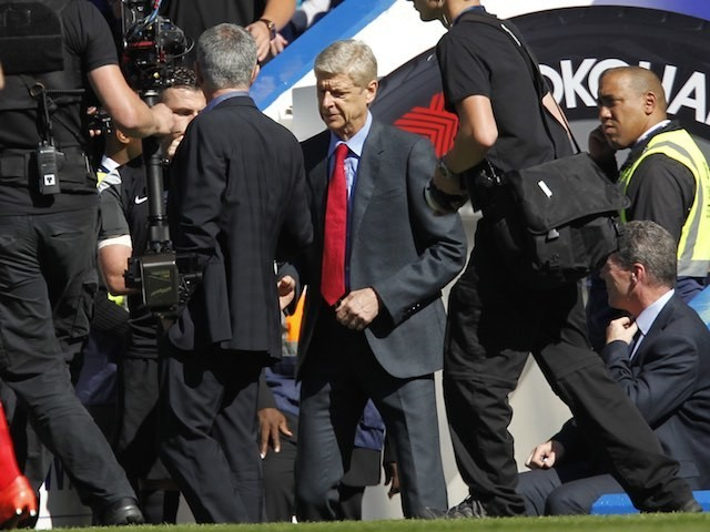 Jose Mourinho and Arsene Wenger shake hands prior to the game between Chelsea and Arsenal on September 19, 2015