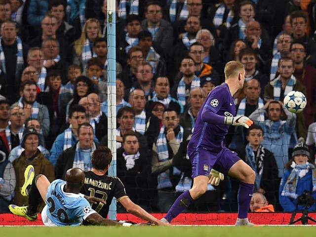 Juventus' forward from Croatia Mario Mandzukic (C) scores past Manchester City's English goalkeeper Joe Hart during a UEFA Champions League group stage football match between Manchester City and Juventus at the Etihad stadium in Manchester, north-west Eng