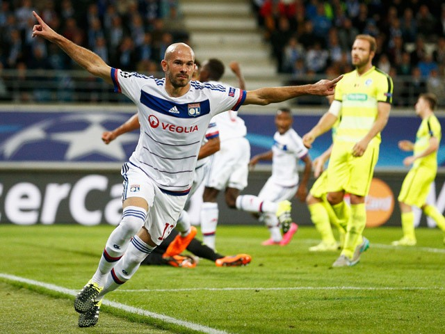 Christophe Jallet of Lyon celebrates scoring his teams first goal of the game during the UEFA Champions League Group H match between KAA Gent and Olympique Lyonnais held at Ghelamco Arena on September 16, 2015