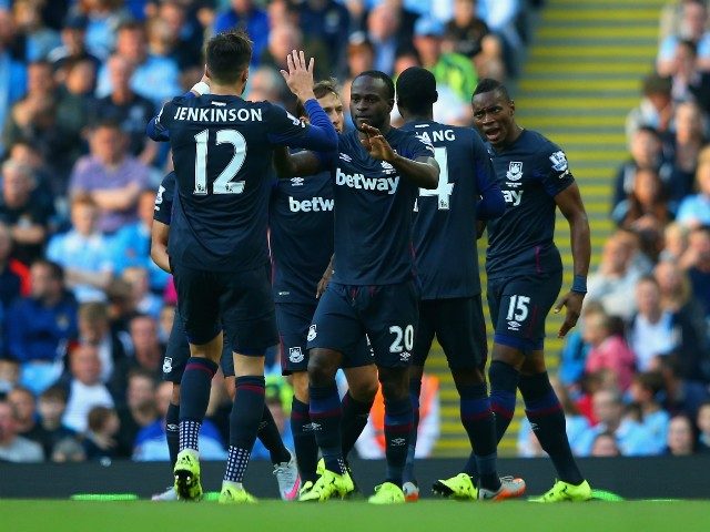 Victor Moses of West Ham United celebrates scoring the opening goal with Carl Jenkinson of West Ham United during the Barclays Premier League match between Manchester City and West Ham United at Etihad Stadium on September 19, 2015 in Manchester, United K
