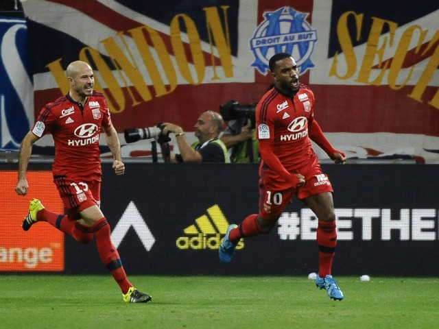 Lyon's French forward Alexandre Lacazette (R) celebrates after scoring a goal during the French L1 football match Marseille (OM) vs Lyon (OL) on September 20, 2015 at Velodrome Stadium in Marseille, southern France.