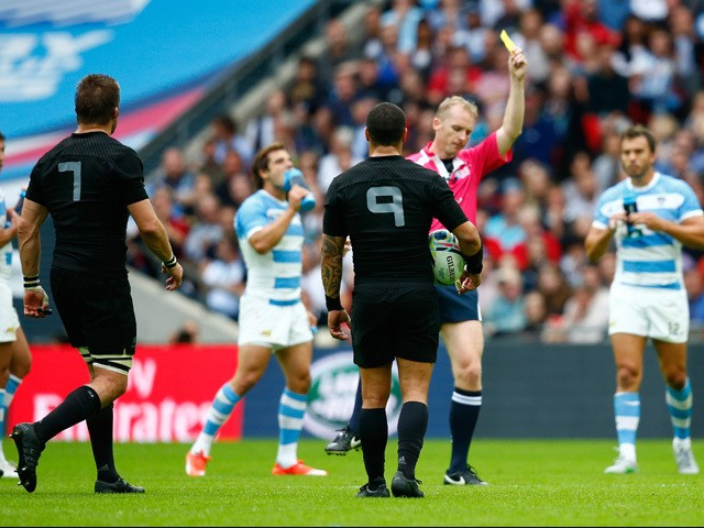 Referee Wayne Barnes shows Richie McCaw of the New Zealand All Blacks a yellow card during the 2015 Rugby World Cup Pool C match between New Zealand and Argentina at Wembley Stadium on September 20, 2015