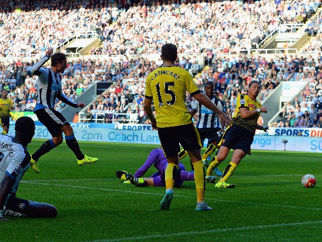 Daryl Janmaat (3rd L) of Newcastle United scores his team's first goal during the Barclays Premier League match between Newcastle United and Watford at St James' Park on September 19, 2015 in Newcastle upon Tyne, United Kingdom