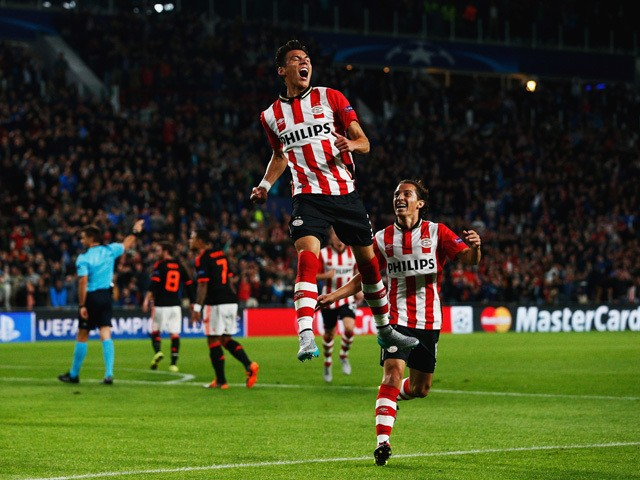 Hector Moreno of PSV Eindhoven celebrates as he scores their first and equalising goal during the UEFA Champions League Group B match between PSV Eindhoven and Manchester United at PSV Stadion on September 15, 2015