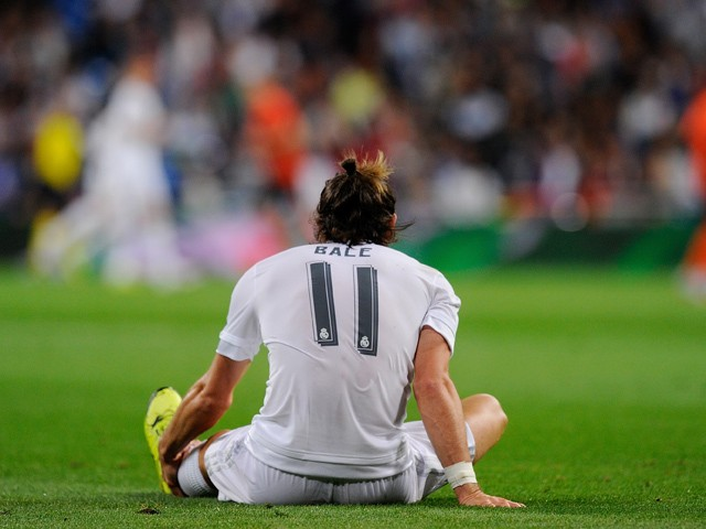 Gareth Bale of Real Madrid reacts after getting injured during the UEFA Champions League Group A match between Real Madrid and Shakhtar Donetsk at estadio Santiago Bernabeu on September 15, 2015