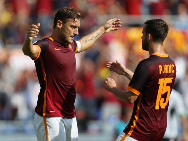 Francesco Totti with his teammate Miralem Pjanic of AS Roma celebrates after scoring their first goal during the Serie A match between AS Roma and US Sassuolo Calcio at Stadio Olimpico on September 20, 2015