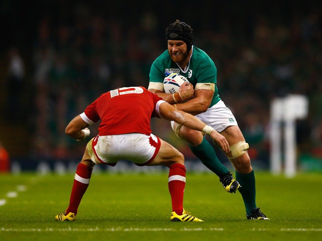 Sean O'Brien of Ireland takes on Matt Evans of Canada during the 2015 Rugby World Cup Pool D match between Ireland and Canada at the Millennium Stadium on September 19, 2015