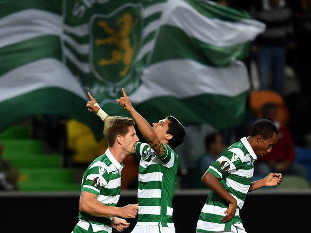 Sporting's Colombian forward Fredy Montero (C) celebrates after scoring the equalizer goal during the UEFA Europa League group H football match Sporting CP vs Lokomotiv Moskva at the Jose Alvalade stadium in Lisbon on September 17, 2015