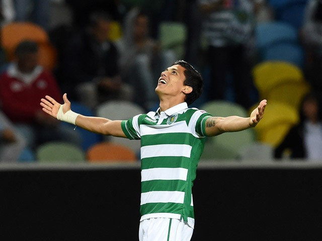 Sporting's Colombian forward Fredy Montero celebrates after scoring the equalizer goal during the UEFA Europa League group H football match Sporting CP vs Lokomotiv Moskva at the Jose Alvalade stadium in Lisbon on September 17, 2015