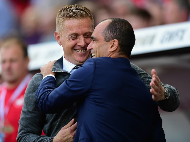 Garry Monk Manager of Swansea City and Roberto Martinez Manager of Everton greet prior to the Barclays Premier League match between Swansea City and Everton at the Liberty Stadium on September 19, 2015 in Swansea, United Kingdom.