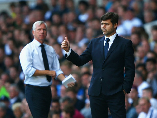 Alan Pardew manager of Crystal Palace looks on as Mauricio Pochettino manager of Tottenham Hotspur gives the thumbs up during the Barclays Premier League match between Tottenham Hotspur and Crystal Palace at White Hart Lane on September 20, 2015