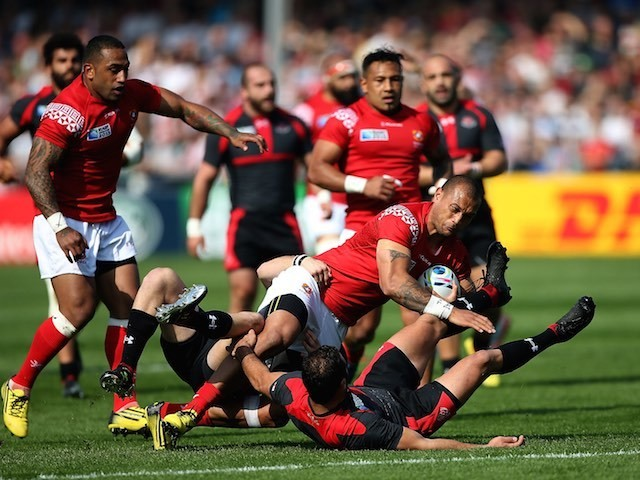 Tonga's Viliami Helu is tackled during the Rugby World Cup match with Georgia on September 19, 2015