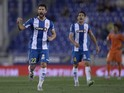 Espanyol's defender Alvaro Gonzalez (L) celebrates a goal next to teammate Espanyol's midfielder Victor Sanchez during the Spanish league football match RCD Espanyol vs Valencia CF at the Power8 stadium in Cornella de Llobregat on September 22, 2015.