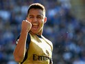 Alexis Sanchez of Arsenal celebrates scoring his team's fourth and his hat trick goal during the Barclays Premier League match between Leicester City and Arsenal at The King Power Stadium on September 26, 2015 in Leicester, United Kingdom.