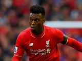 Daniel Sturridge of Liverpool breaks away from Graham Dorrans of Norwich City during the Barclays Premier League match between Liverpool and Norwich City at Anfield on September 20, 2015