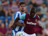 Jordan Brown of West Ham United battles with Joe Edwards of Colchester United during the pre season friendly match between Colchester and West Ham United at Weston Homes Community Stadium on July 21, 2015