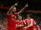 Juan Mata of Manchester United celebrates scoring his team's third goal during the Barclays Premier League match between Manchester United and Sunderland at Old Trafford on September 26, 2015 in Manchester, United Kingdom.