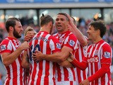 Jonathan Walters (2nd R) of Stoke City celebrates scoring his team's first goal with his team mates during the Barclays Premier League match between Stoke City and A.F.C. Bournemouth at Britannia Stadium on September 26, 2015