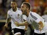Valencia's German defender Shkodran Mustafi celebrates his goal during the Spanish league football match Valencia CF vs Granada CF at the Mestalla stadium in Valencia on September 25, 2015