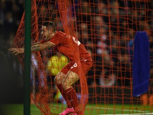 Liverpool's English striker Danny Ings celebrates in the net after scoring the opening goal of the English League Cup third round football match between Liverpool and Carlisle United at Anfield in Liverpool, north west England on September 23, 2015