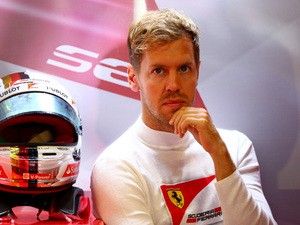 Sebastian Vettel of Germany and Ferrari looks on as he sits in the garage during final practice for the Formula One Grand Prix of Italy at Autodromo di Monza on September 5, 2015