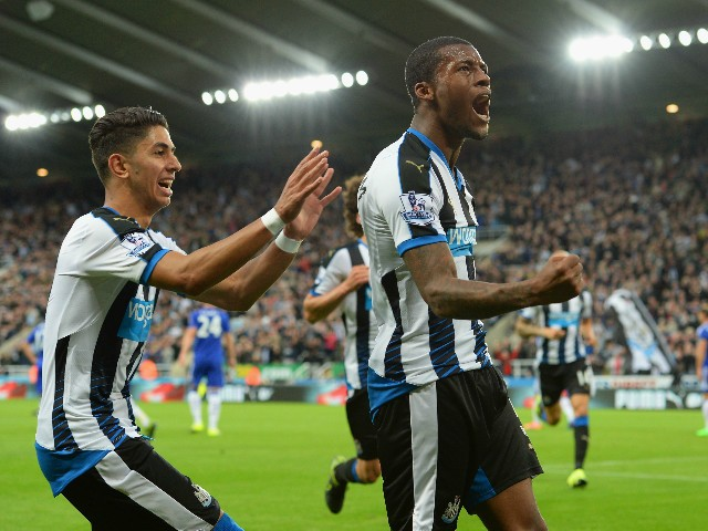 Georginio Wijnaldum (R) of Newcastle United celebrates scoring his team's second goal with his team mate Ayoze Perez (L) during the Barclays Premier League match between Newcastle United and Chelsea at St James' Park on September 26, 2015 in Newcastle upo