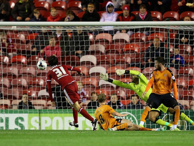 Diego Fabbrini of Middlesbrough shoots past Carl Ikeme, Goalkeeper of Wolverhampton Wanderers for the second goal during the Capital One Cup third round match between Middlesbrough and Wolverhampton Wanderers at Riverside Stadium on September 22, 2015 in