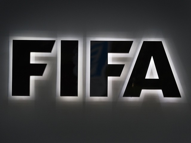 A photo shows the FIFA sign at the entrance of the world football's governing body headquarters in Zurich taken on September 25, 2015