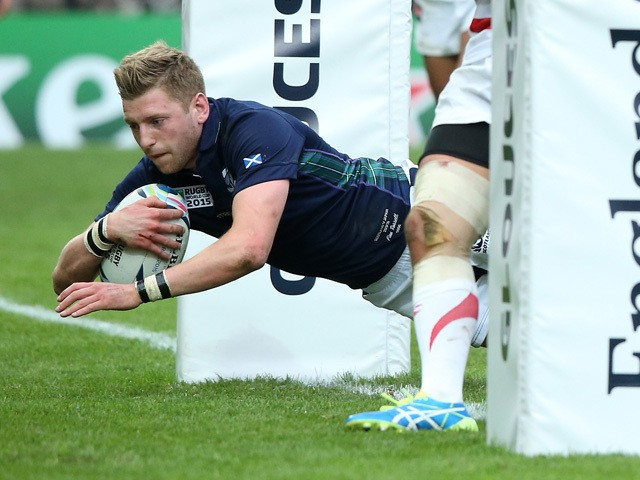 Finn Russell of Scotland dives over for a try during the 2015 Rugby World Cup Pool B match between Scotland and Japan at Kingsholm Stadium on September 23, 2015