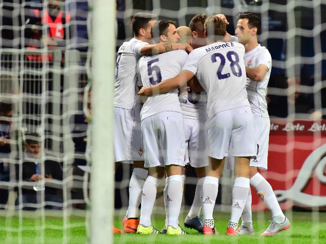 Fiorentina's Slovenian midfielder Josip Ilicic celebrates with teammates after scoring a penalty during the Serie A football match between Inter Milan and Fiorentina at the San Siro Stadium in Milan on September 27, 2015