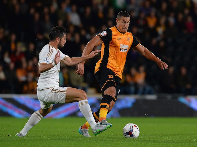 Jordi Amat of Swansea City tackles Jake Livermore of Hull City during the Capital One Cup third round match between Hull City and Swansea City at KC Stadium on September 22, 2015 in Hull, England.