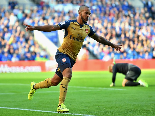 Theo Walcott of Arsenal celebrates scoring his team's first goal during the Barclays Premier League match between Leicester City and Arsenal at The King Power Stadium on September 26, 2015 in Leicester, United Kingdom.