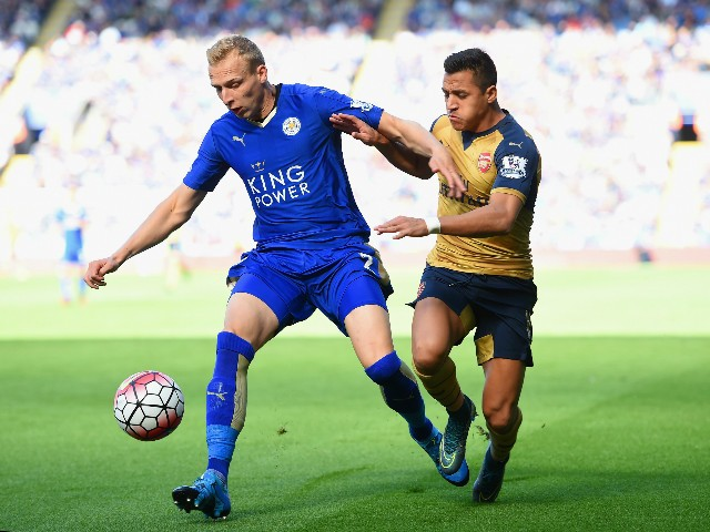 Ritchie De Laet of Leicester City and Alexis Sanchez of Arsenal compete for the ball during the Barclays Premier League match between Leicester City and Arsenal at The King Power Stadium on September 26, 2015 in Leicester, United Kingdom.