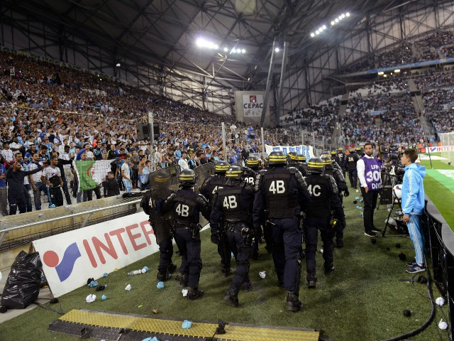 Riot police are pictured during a game interruption after crowd trouble during the French L1 football match Marseille (OM) vs Lyon (OL) on September 20, 2015 at Velodrome Stadium in Marseille, southern France. The match restarted after a 20-minute delay.