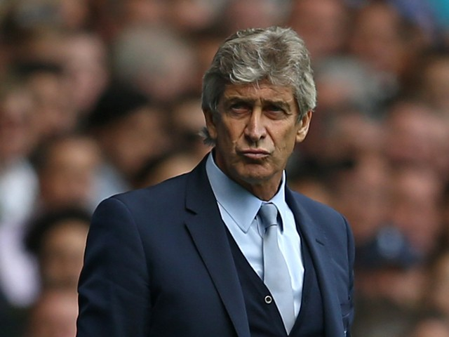 Manchester City's Chilean manager Manuel Pellegrini reacts during the English Premier League football match between Tottenham Hotspur and Manchester City at White Hart Lane in north London on September 26, 2015
