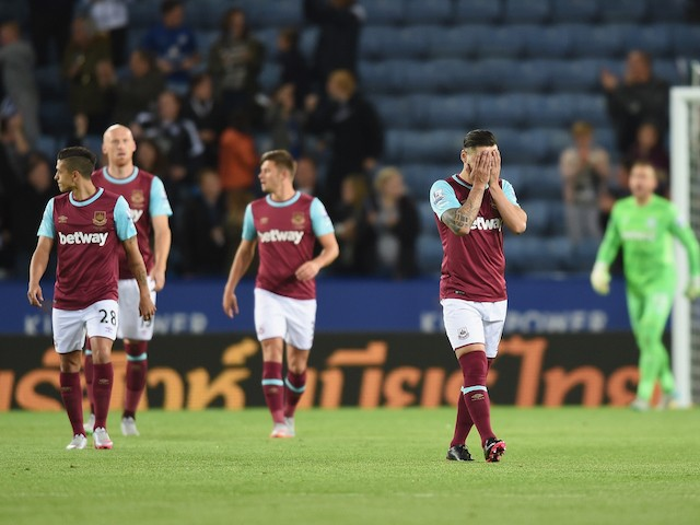 Mauro Zarate of West Ham looks dejected after the first Leicester goal during the Capital One Cup Third Round match between Leicester City and West Ham United at The King Power Stadium on September 22, 2015 in Leicester, England.