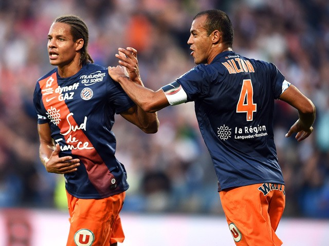 Montpellier's French defender Daniel Congre (L) and Montpellier's Brazilian defender Vitorino Hilton react after scoring a goal during the French L1 football match between MHSC Montpellier and Monaco, on September 24, 2015