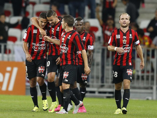 Nice's French forward Hatem Ben Arfa is congratulated by teammates after scoring a goal during the French L1 football match Nice (OGC Nice) vs Bordeaux (GB) on September 23, 2015