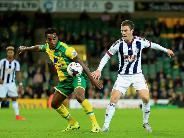 Andre Wisdom of Norwich City and Craig Gardner of West Bromwich Albion compete for the ball during the Capital One Cup Third Round match between Norwich City and West Bromwich Albion at Carrow Road on September 23, 2015