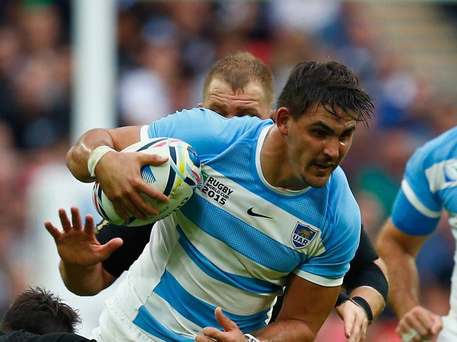 Pablo Matera of Argentina is tackled by Dan Carter of the New Zealand All Blacks during the 2015 Rugby World Cup Pool C match between New Zealand and Argentina at Wembley Stadium on September 20, 2015