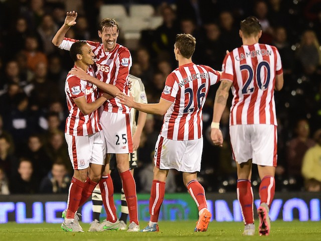 Peter Crouch (2nd L) of Stoke City celebrates after scoring his team's first goal during the Capital One Cup Third Round match between Fulham and Stoke City at Craven Cottage on September 22, 2015 in London, United Kingdom.