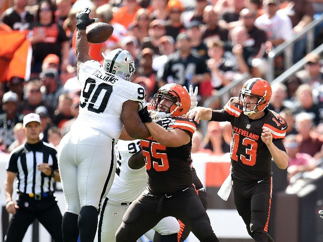 Dan Williams #90 of the Oakland Raiders blocks a pass by Josh McCown #13 in front of Alex Mack #55 of the Cleveland Browns during the first quarter at FirstEnergy Stadium on September 27, 2015 in Cleveland, Ohio.