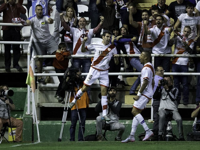 Roberto Tashorras (L) of Rayo Vallecano de Madrid celebrates scoring their opening goal during the La Liga match between Rayo Vallecano de Madrid and Real Sporting de Gijon at Estadio de Vallecas on September 23, 2015