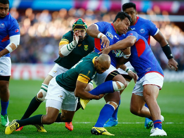Ofisa Treviranus of Samoa is tackled by JP Pietersen of South Africa during the 2015 Rugby World Cup Pool B match between South Africa and Samoa at Villa Park on September 26, 2015 in Birmingham, United Kingdom.