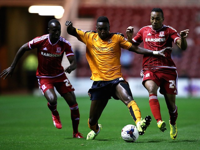 Sylvain Deslandes of Wolverhampton Wanderers battles with Albert Adomah and Emilio Nsue of Middlesbrough during the Capital One Cup third round match between Middlesbrough and Wolverhampton Wanderers at Riverside Stadium on September 22, 2015 in Middlesbr